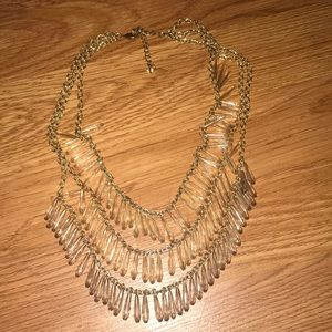 Triple tiered tinted beaded necklace